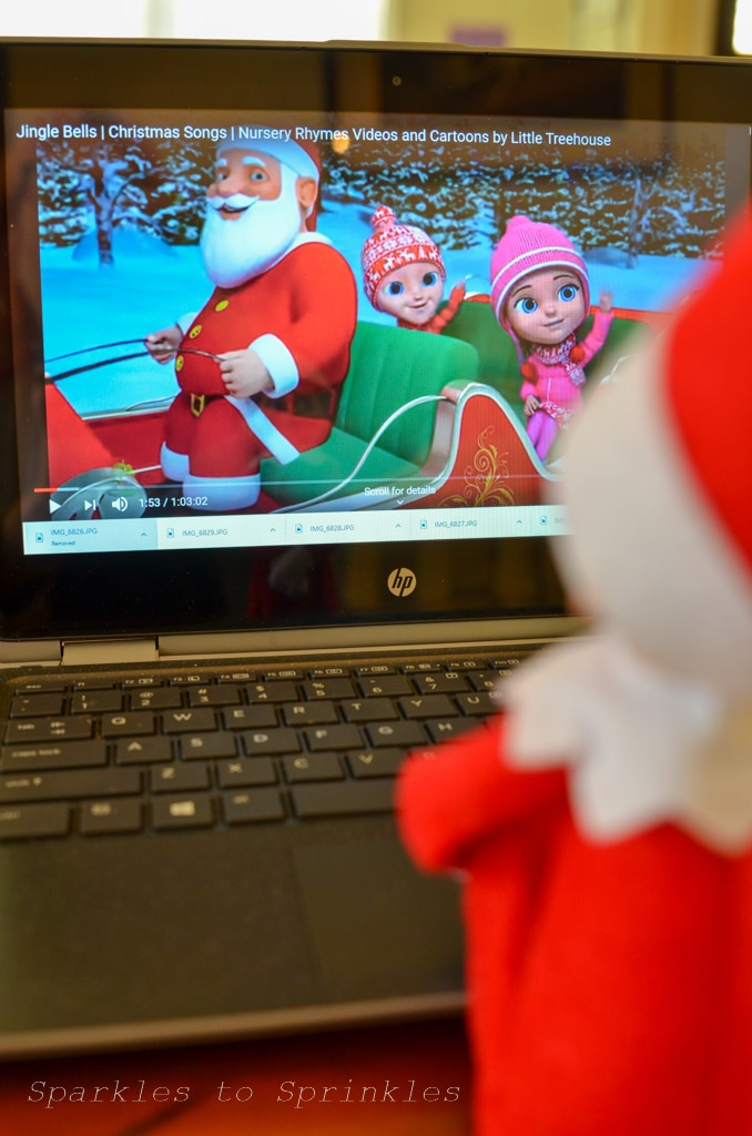 elf on the shelf watching santa