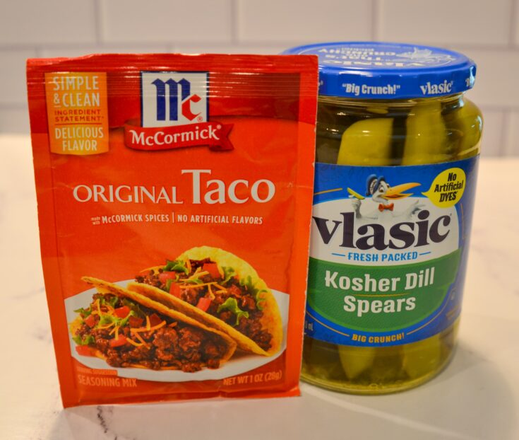 taco seasoning packet leaning on a pickle jar